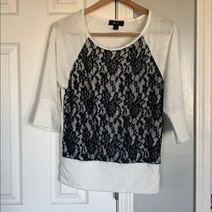 BCX cream with black lace top. Size medium.